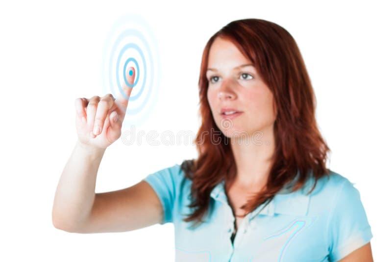 Donna in azzurro che tocca lo schermo fotografia stock