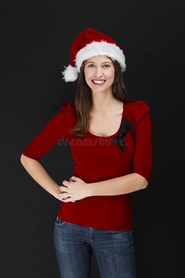 Donna bella che porta un cappello di Santa fotografia stock