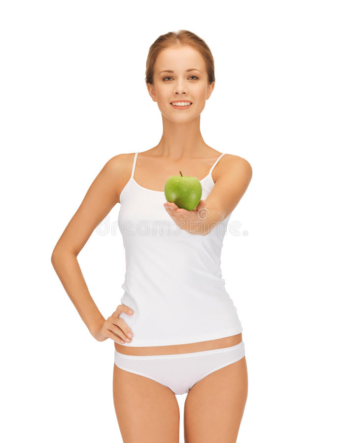Donna in biancheria intima bianca che tiene mela verde fotografie stock libere da diritti