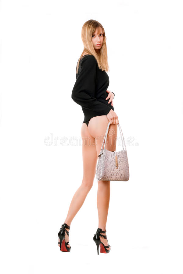 Donna bionda con la borsa bianca immagini stock libere da diritti