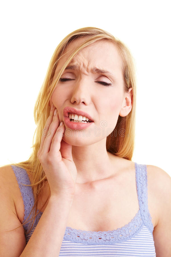 Donna bionda con mal di denti immagini stock