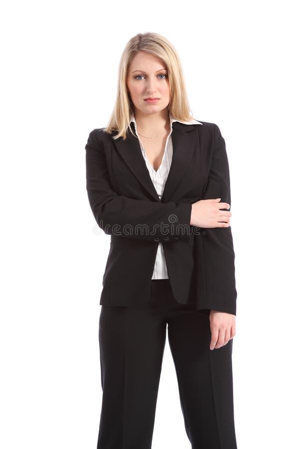 Donna bionda seria di affari in vestito nero fotografia stock libera da diritti