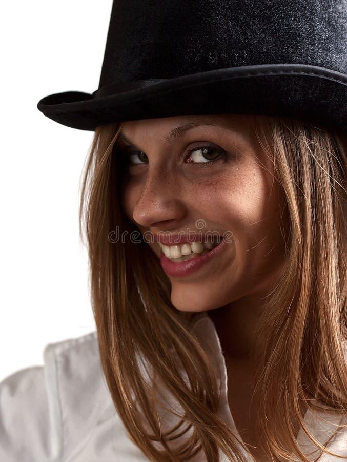 Donna in black hat fotografia stock