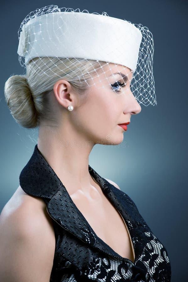 Donna in cappello bianco fotografia stock