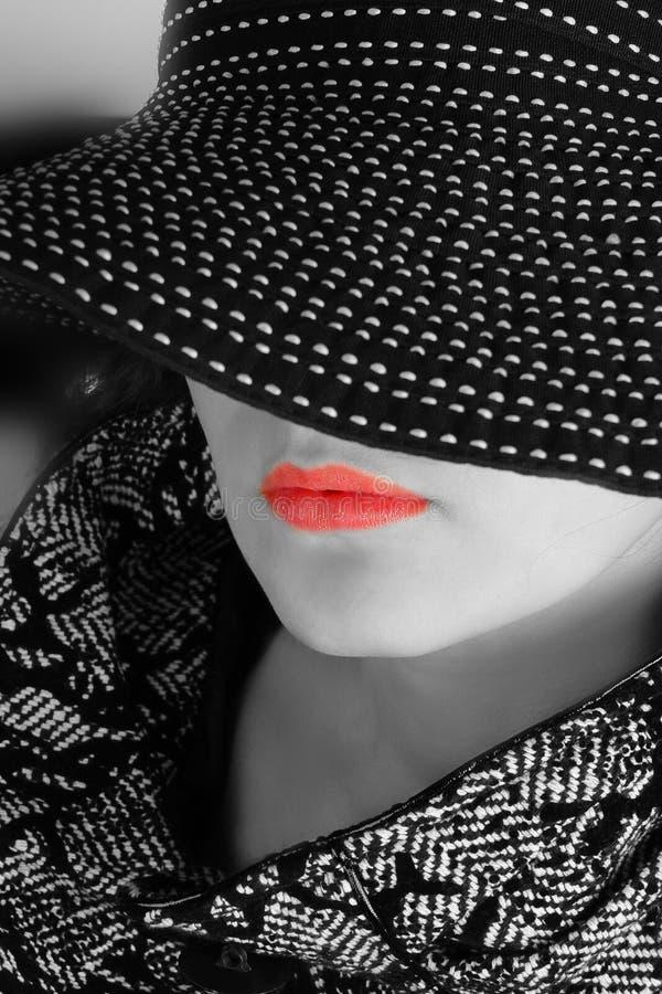 Donna in cappello in bianco e nero fotografie stock