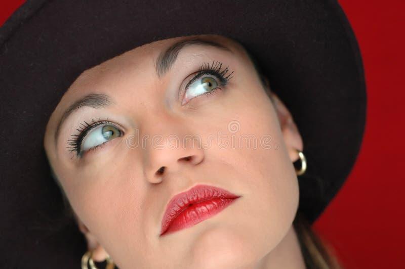 Donna in cappello nero 3 fotografie stock