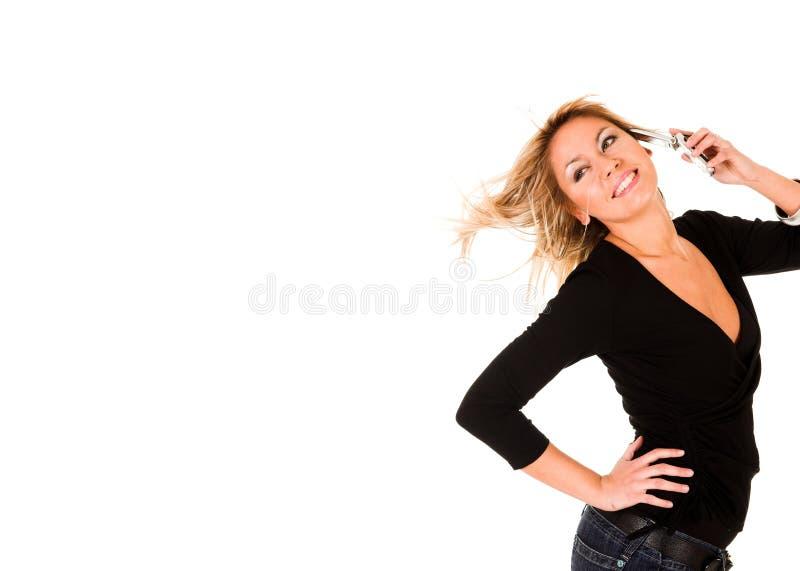 Donna che chiama dal telefono mobile fotografie stock