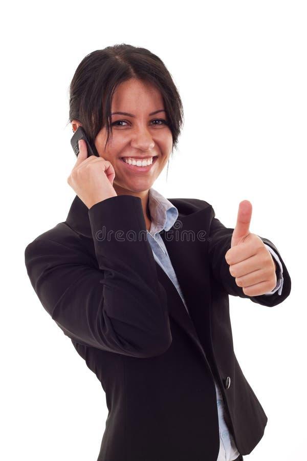 Donna che comunica dal telefono delle cellule fotografia stock