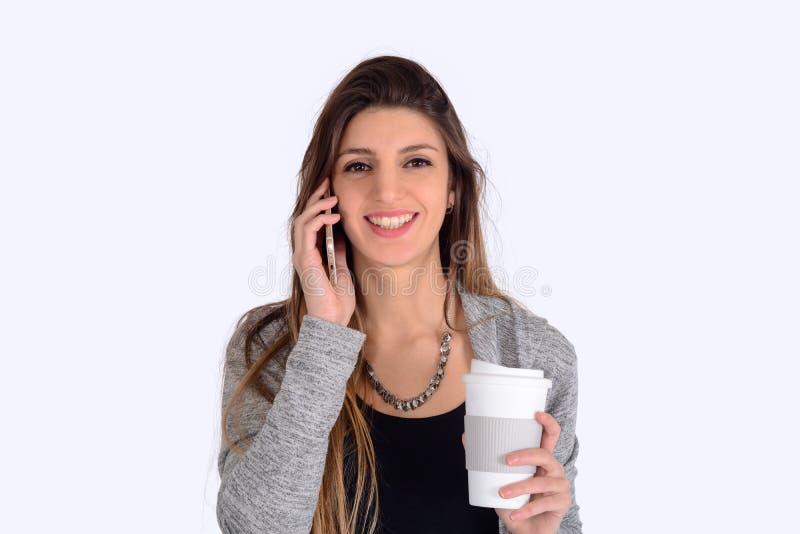 Donna che comunica sul telefono fotografie stock