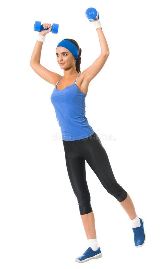 Donna che fa esercitazione di forma fisica, su bianco immagine stock
