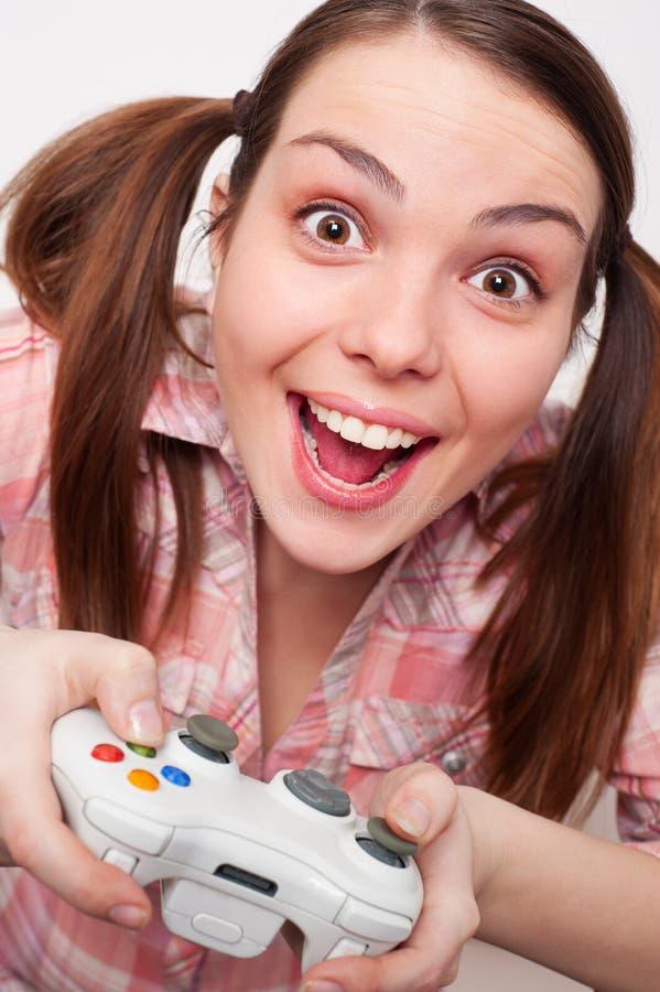 Donna che gioca video gioco immagine stock libera da diritti