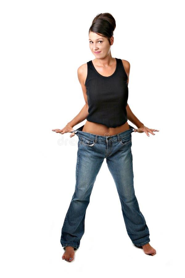 Donna che ha incontrato il suo obiettivo di perdita di peso ed è felice fotografie stock libere da diritti