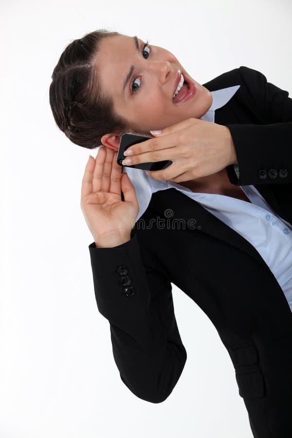 Donna che ha udienza di difficoltà fotografia stock libera da diritti