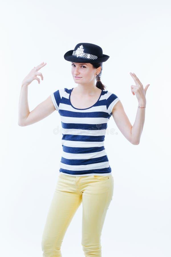 Donna che imita un ufficiale di polizia fotografia stock