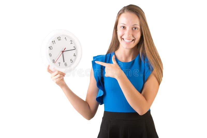 Donna che indica all'orologio immagini stock libere da diritti