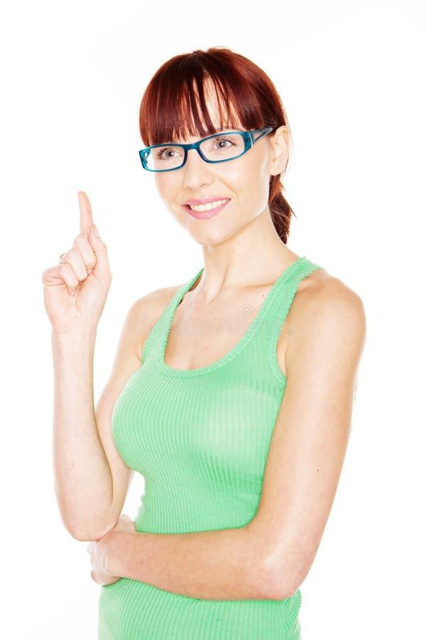 Donna che indica con il dito indice immagine stock