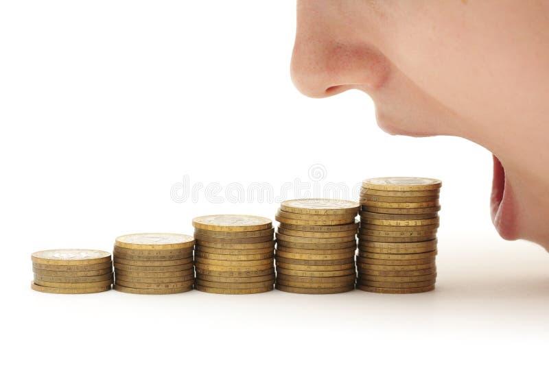 Donna che mangia soldi immagini stock libere da diritti