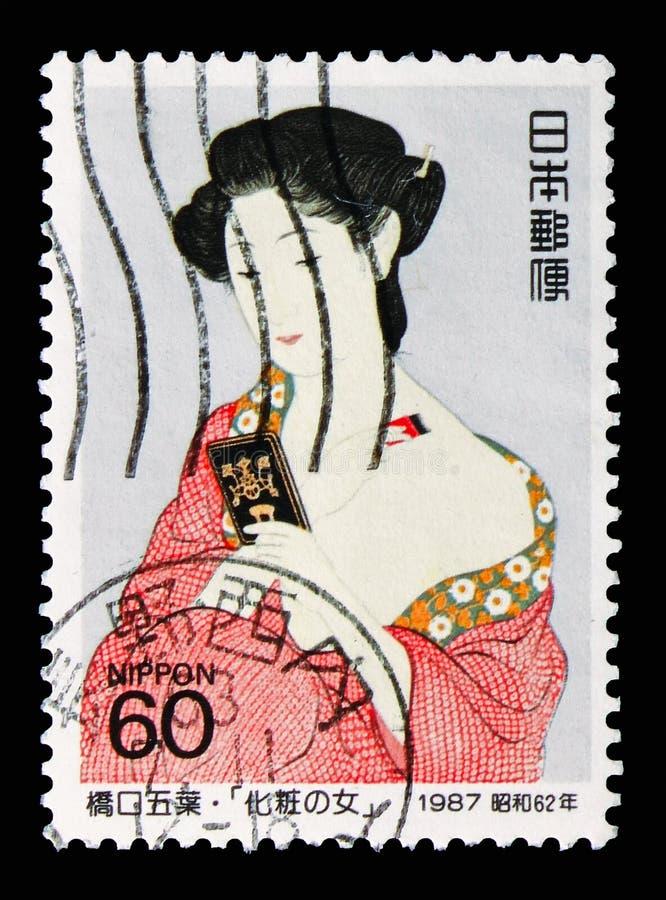 Donna che mette sul trucco, serie filatelico 1987 di settimana, circa 1987 immagini stock libere da diritti
