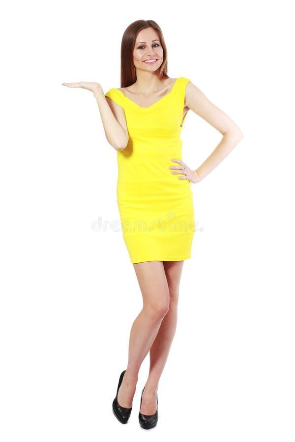 Download Donna che mostra immagine stock. Immagine di pantaloni - 55351679