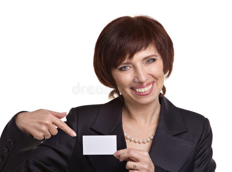 Donna che mostra carta fotografia stock