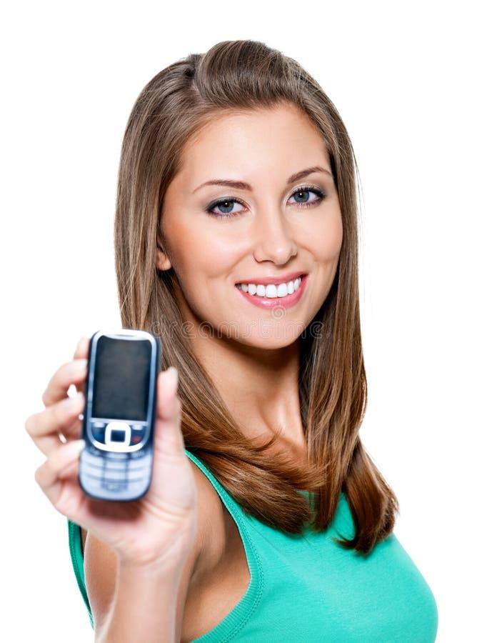 Donna che mostra telefono mobile immagine stock libera da diritti