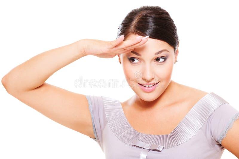 Donna che osserva in avanti immagine stock