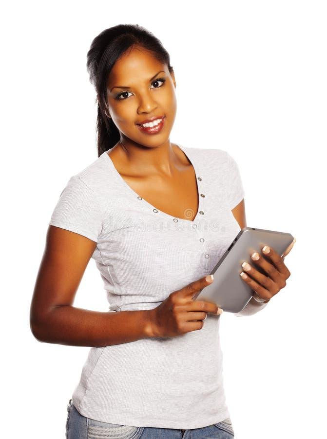 Donna che per mezzo di un PC del ridurre in pani immagini stock libere da diritti