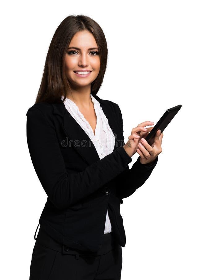 Donna che per mezzo di un ridurre in pani digitale fotografia stock