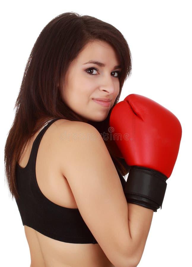 Donna che porta il guanto di inscatolamento rosso fotografie stock libere da diritti
