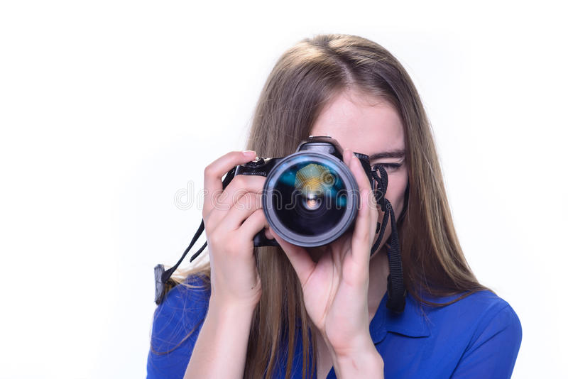 Donna che prende una foto con una macchina fotografica immagini stock