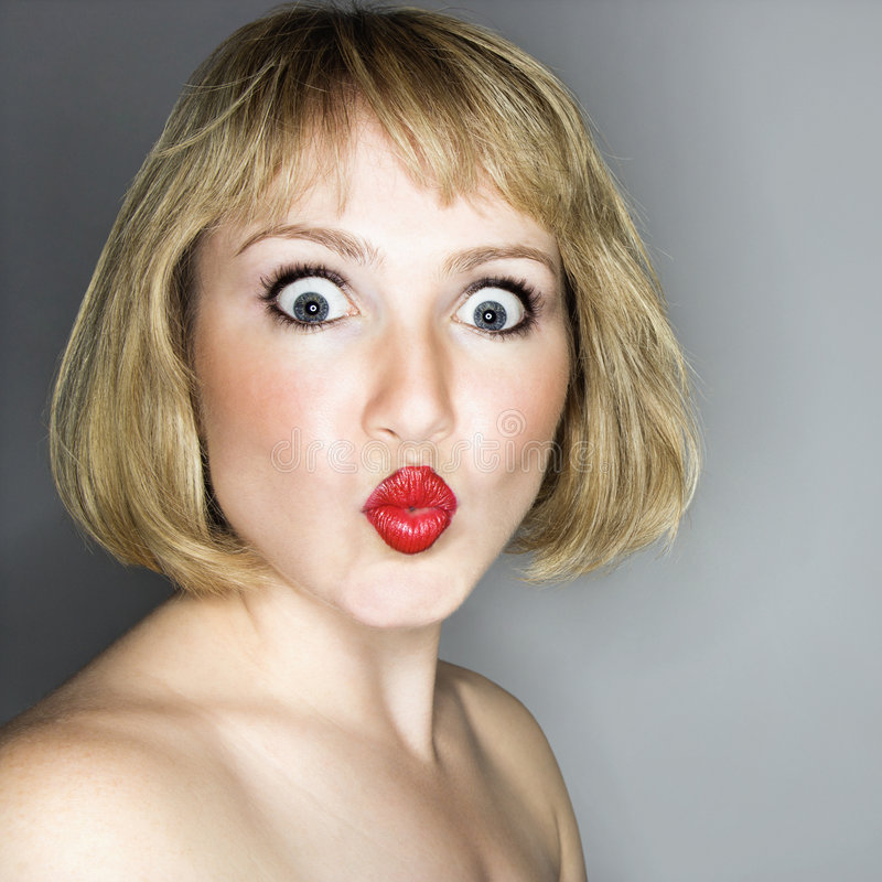 Donna che sembra sorpresa. fotografia stock