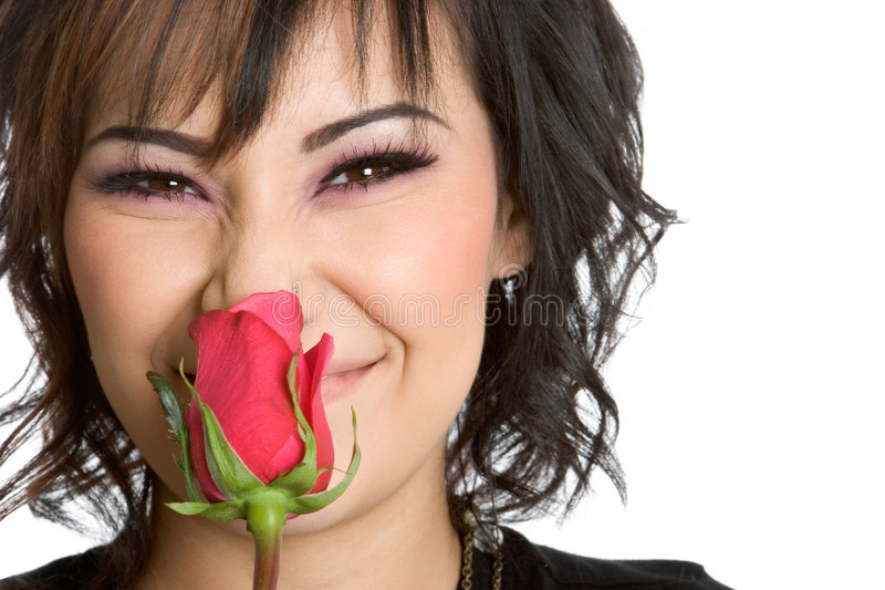 Donna che sente l'odore di Rosa immagine stock libera da diritti