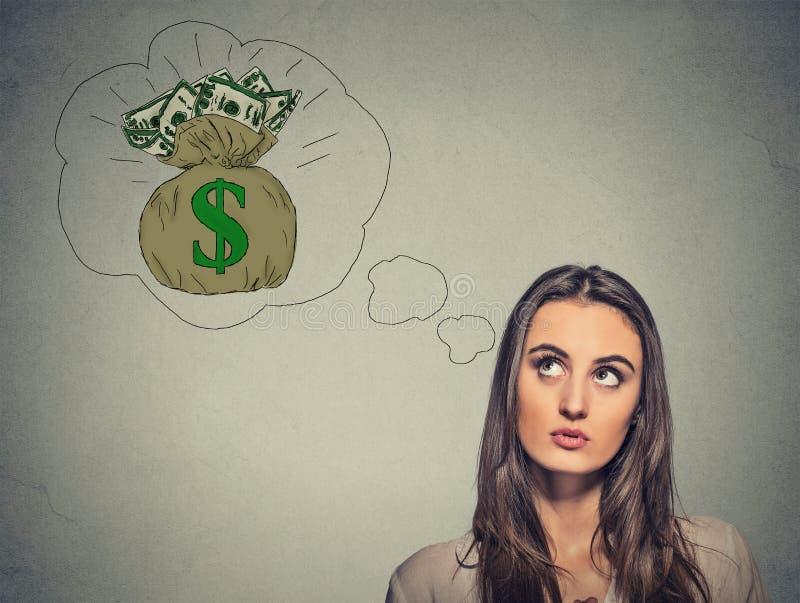 Donna che sogna dei soldi finanziari di successo immagini stock