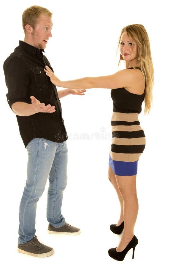 Donna che spinge uomo via mentre si domanda perché immagini stock libere da diritti