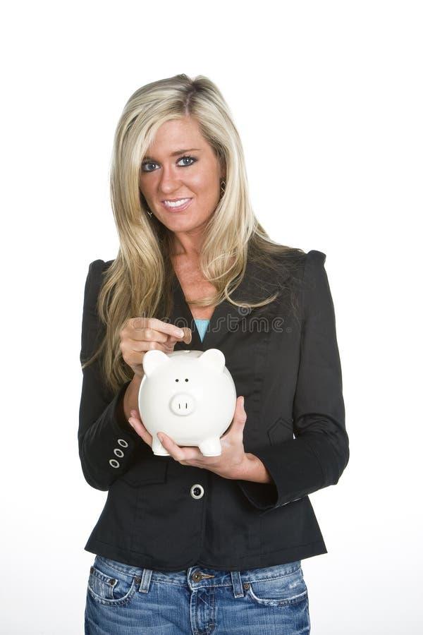 Donna che tiene la Banca Piggy fotografia stock