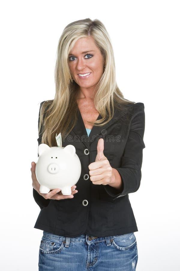 Donna che tiene la Banca Piggy immagine stock libera da diritti