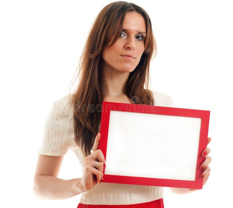 Donna che tiene segno in bianco immagine stock libera da diritti