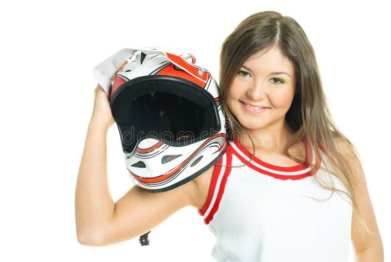 Donna che tiene un casco del motociclo fotografia stock