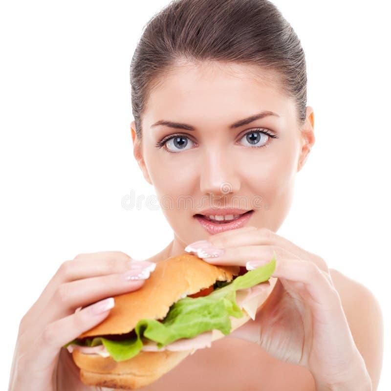 Donna che tiene un panino fotografia stock