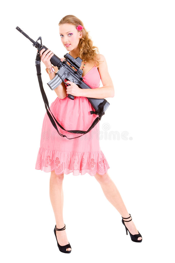 Donna che tiene una pistola immagini stock libere da diritti
