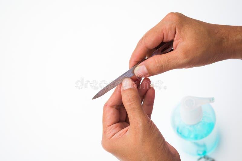 Donna che usando l'archivio di chiodo per il trattamento di bellezza immagine stock