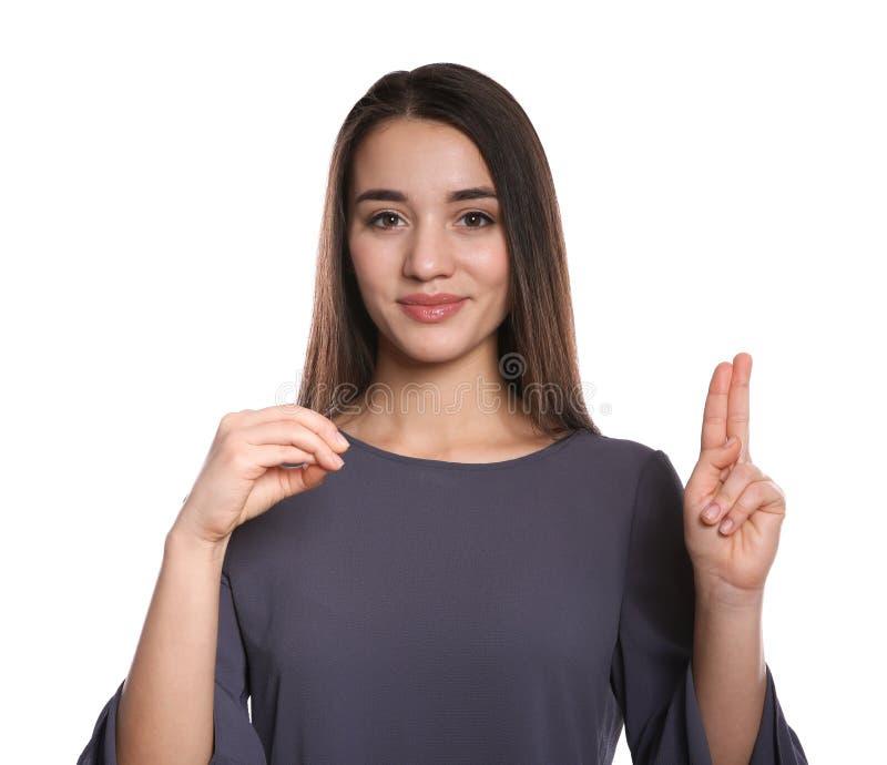 Donna che usando linguaggio dei segni su bianco immagini stock