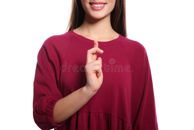 Donna che usando linguaggio dei segni su bianco fotografia stock