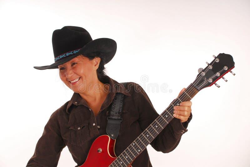 Donna cinque della chitarra fotografia stock