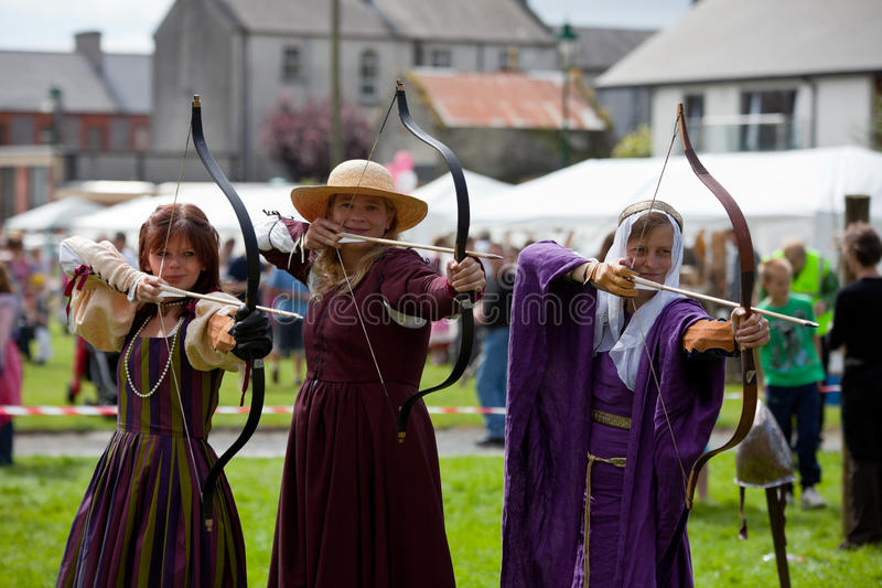 Donna, Claire And Katia Displays Archery Editorial Photo