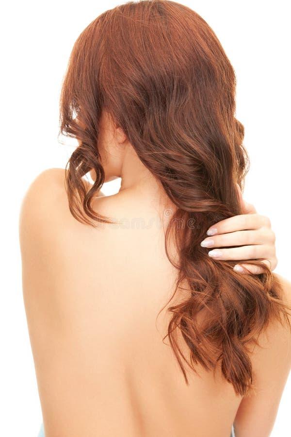 Donna con capelli lunghi dalla parte posteriore fotografia stock