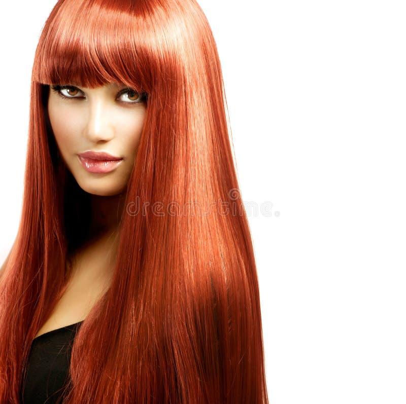 Donna con capelli rossi lunghi fotografia stock libera da diritti