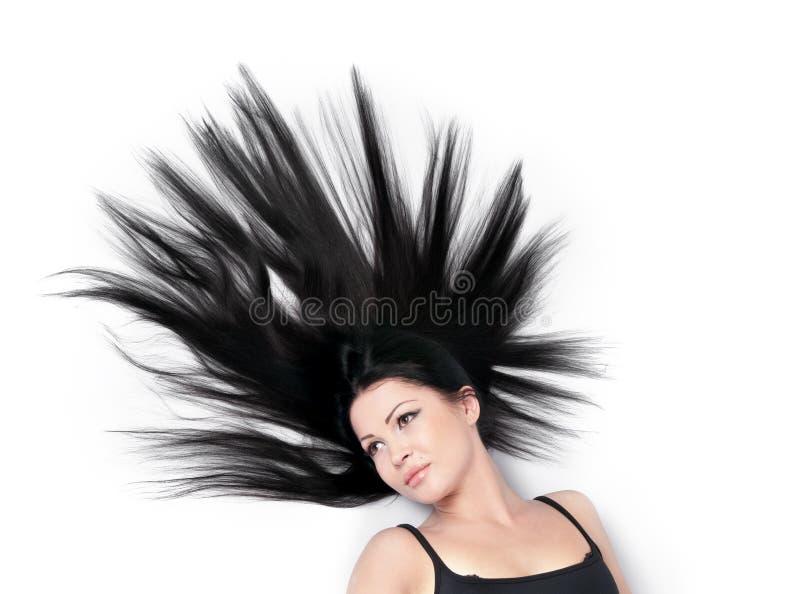 Donna con capelli sparsi magnifici su bianco fotografia stock
