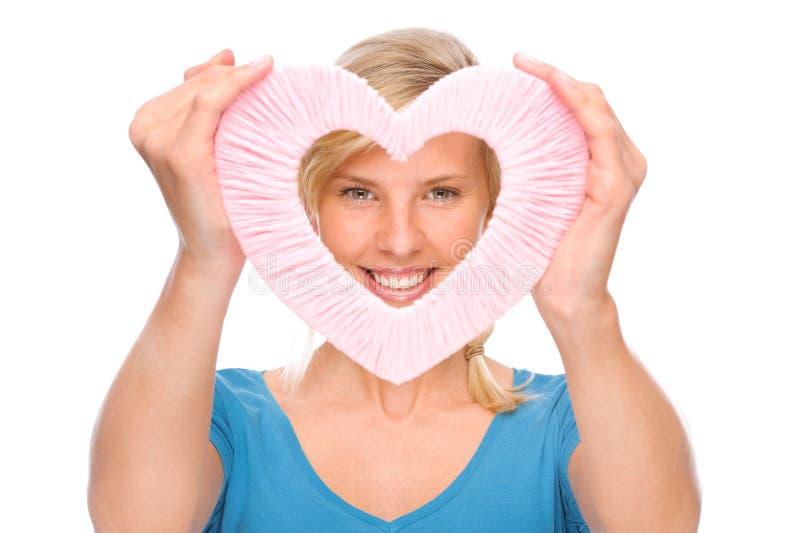 Donna con cuore immagine stock