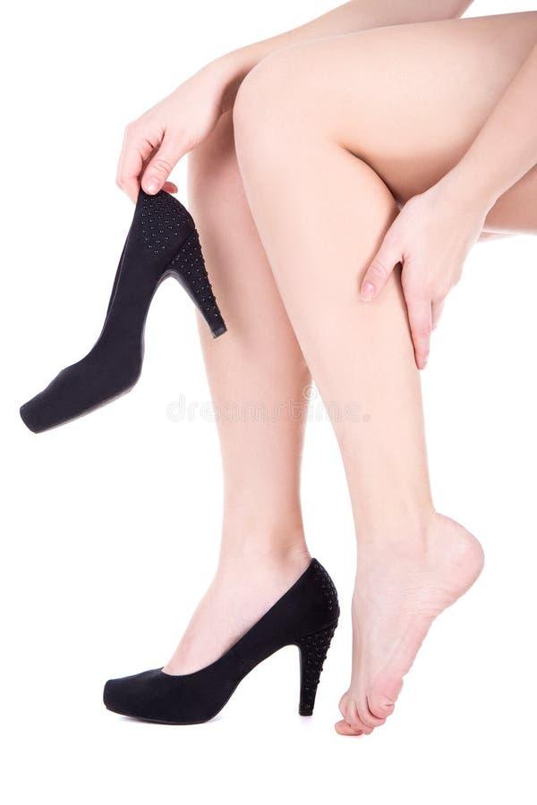 Donna con dolore della caviglia o callo isolato su bianco immagine stock libera da diritti